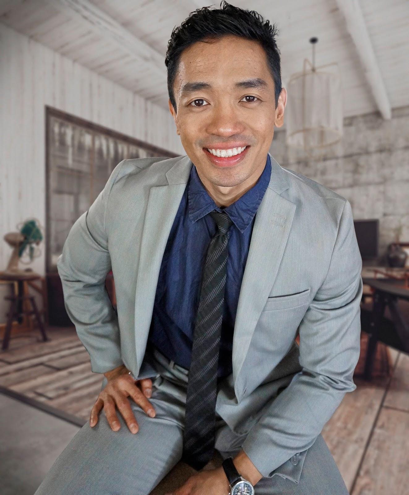 Rone John in gray suit
